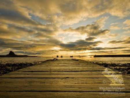 Lindisfarne and Bamburgh Castles sunrise photo