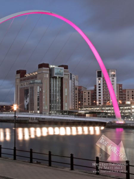 Millennium Bridge lit up in pink photograph