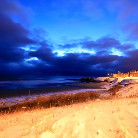 tynemouth Longsands covered in snow photo