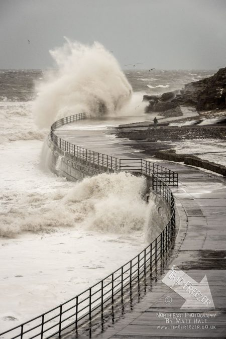 big waves crashing on the promenade in Cullercoats