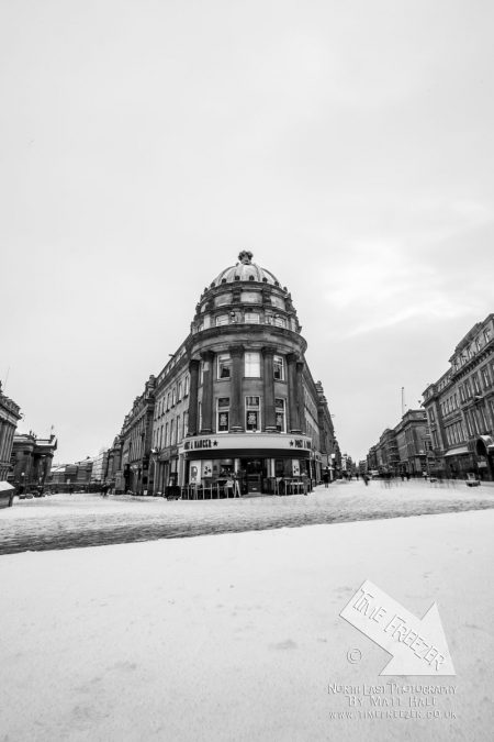 The corner of Grainger and Grey Street in Snow