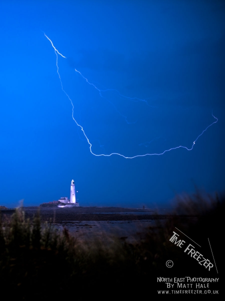 Lightning strike over st marys lighthouse