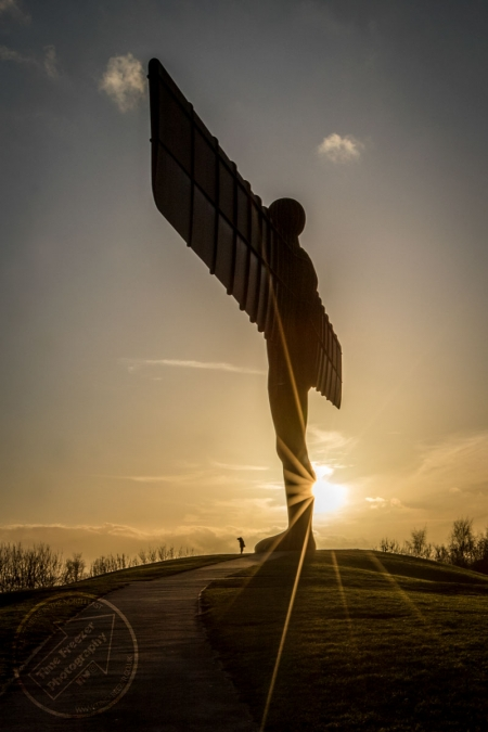 little boy next to the angel of the north