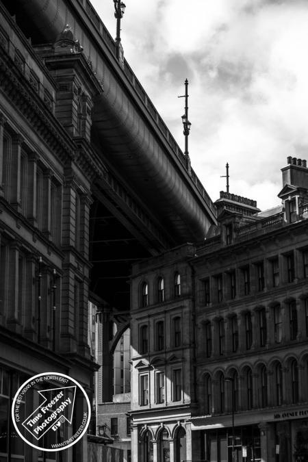 Tyne Bridge cutting through the Newcastle Quayside